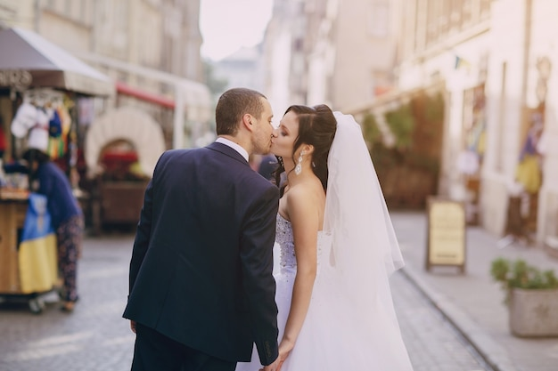 Rear view of newlyweds giving a kiss