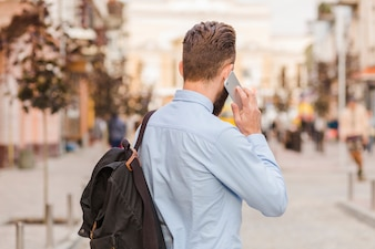 Rear view of a man talking on cellphone