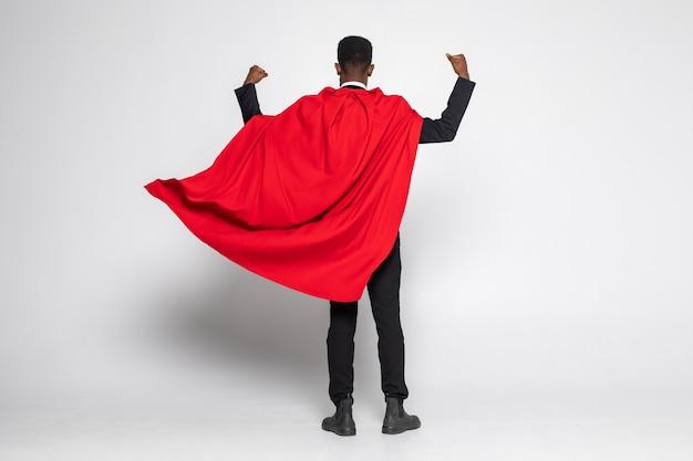 아프리카 사업가의 후면보기 손의 강한 표시