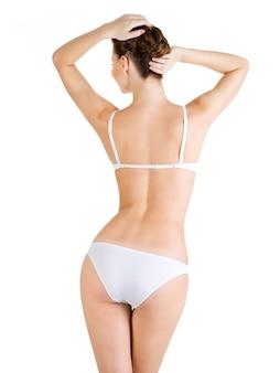 美しい女性の体の背面図。白で隔離。