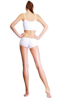 긴 다리를 가진 아름 다운 여자 모양의 후면보기
