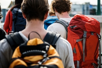 Rear view of walking backpackers group