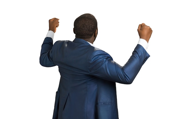 Rear view of successful businessman. black manager standing with fists up.