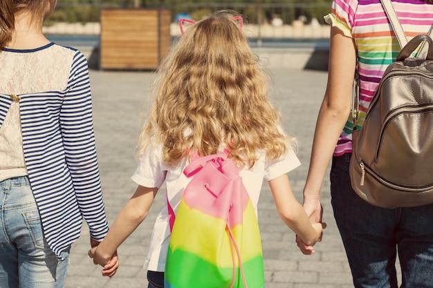 Rear view of three girls children