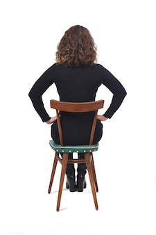 Rear view of a woman sitting on chair