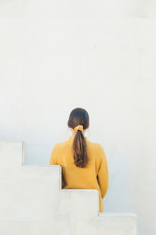 Rear view of  a woman with pony tail