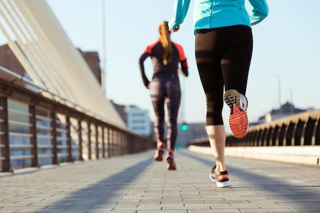 Rear view of women running Premium Photo