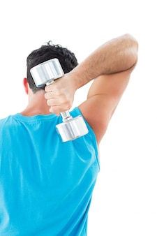 Rear view of a young man exercising with dumbbell