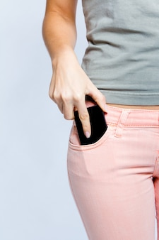 Rear white phone jeans bottom