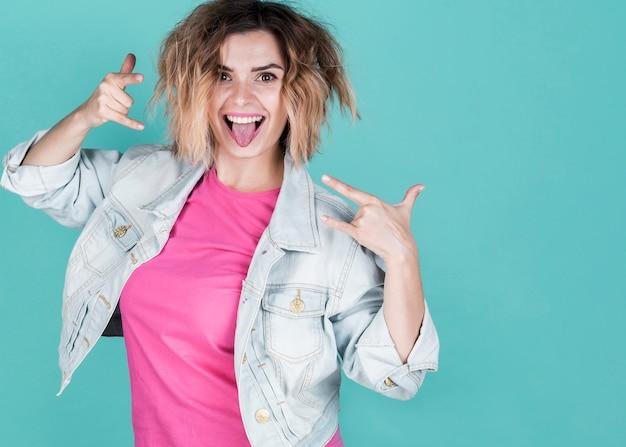 Rebel model showing rock sign