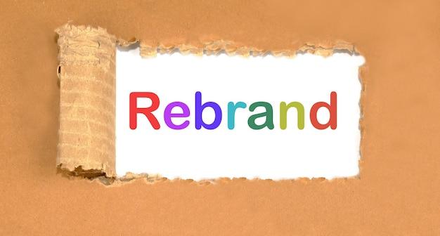 Rebrand lettering on torn cardboard