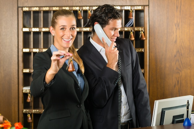 Reception in hotel, man and woman