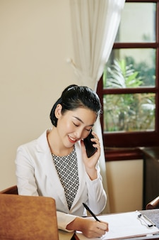 Receptionist calling on phone