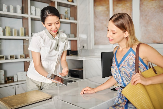 Receptionists showing catalog