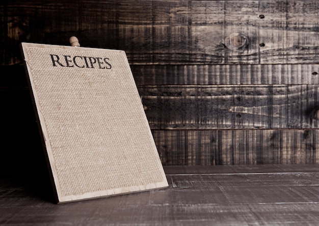 Recipes wooden board for kitchen on wooden table