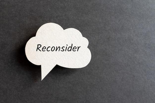 Reconsider word written on cardboard speech bubble