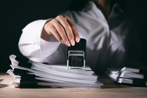 Record or permit document paper stamper in office.