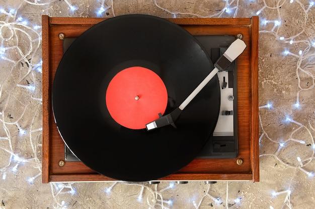 Record player and christmas decor on grey