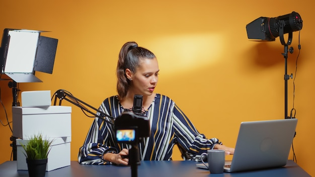 Recording big gift giveaway from new media star in professional studio set. creative content creator social influencer expert vlogger recording online internet web podcast for subscribers audience