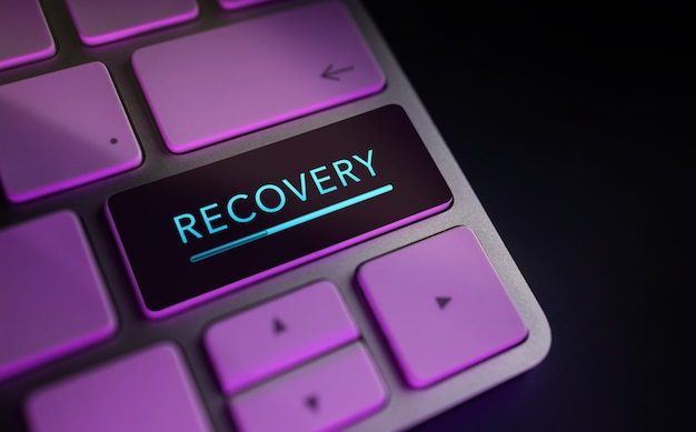 Recovery in digital life or business concept. economic crisis symbolic. close up of rocket and startup sign on computer keyboard. dark tone