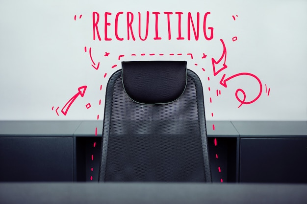 Recruiting concept with an office chair with nobody.