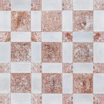 赤い石の壁の四角形のテクスチャ