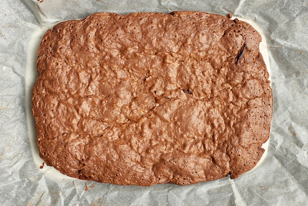 Rectangular baked brownie chocolate cake with cracked surface