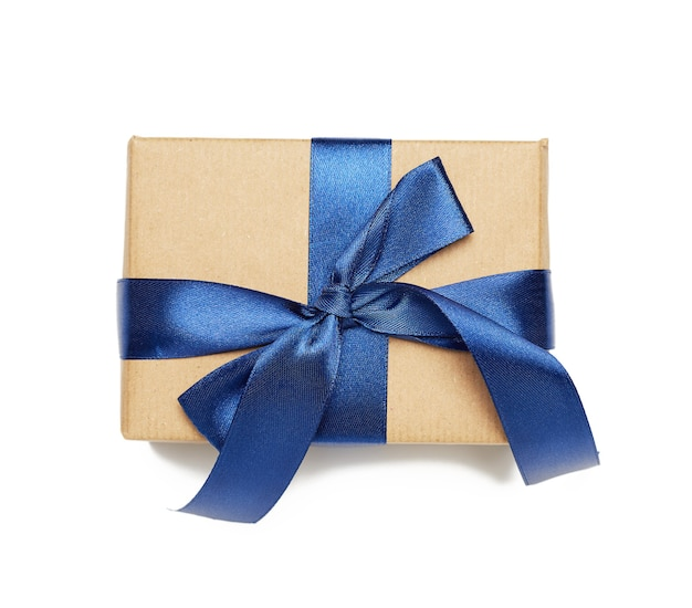 Rectangular box wrapped in brown paper and tied with silk ribbon with a bow