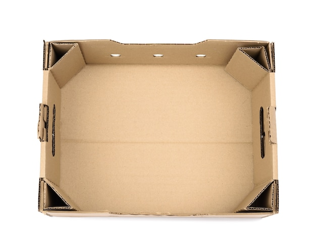 Rectangular empty cardboard box of brown paper on white, box without a lid for vegetables and fruits in with holes