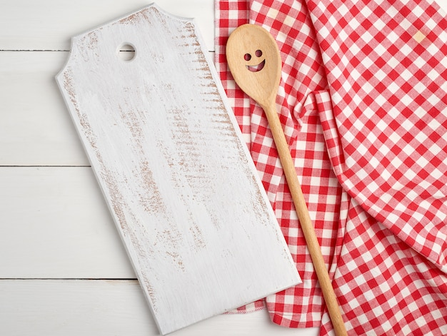 Rectangular empty wooden cutting boards and red towel
