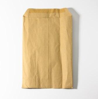 Rectangular open brown kraft paper envelope on white background