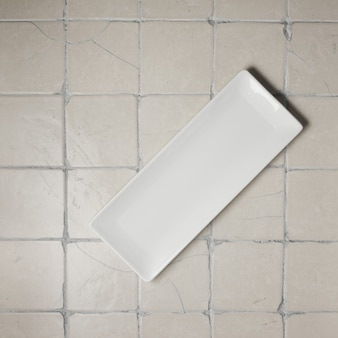Rectangular plate on a tile - top view