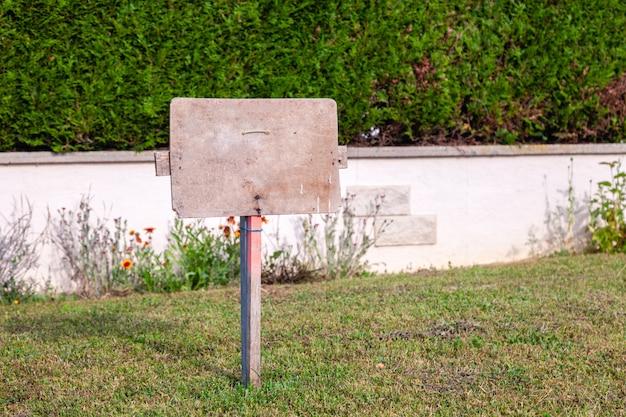 Rectangular stone blank sign on the grass