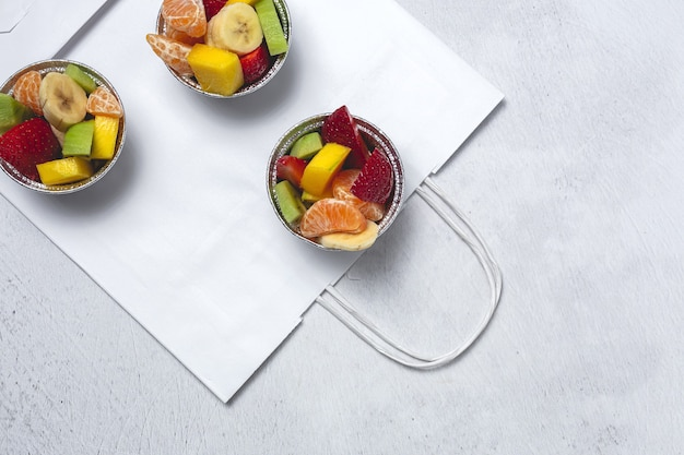 Recyclable take away fruit cups.vegan food concept. delivery