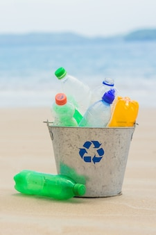 Recycle, basket with plastic bottle at the beach