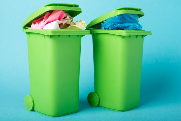 Recycle bins on blue background. paper and polyethylene. waste recycling