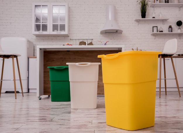 Recycle bins in the kitchen. household waste sorting. environmentally responsible behavior. zero waste
