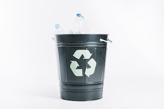 Recycle bucket with plastic bottles on white background