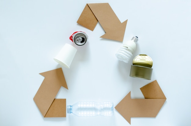 Recycle eco symbol with materials on white
