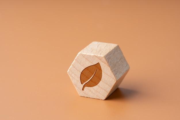 Recycle icon on hexagon wood block