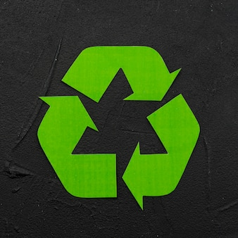 Recycle logo on black plaster background