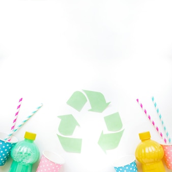 Recycle logo with bottles and cups