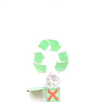 Recycle logo with garbage bin and globe