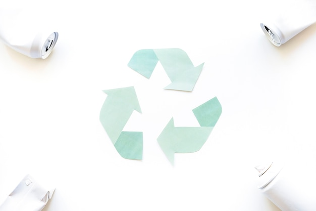 Recycle logo with garbage in corners