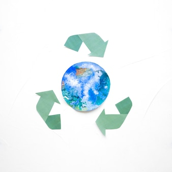 Recycle logo with globe drawing