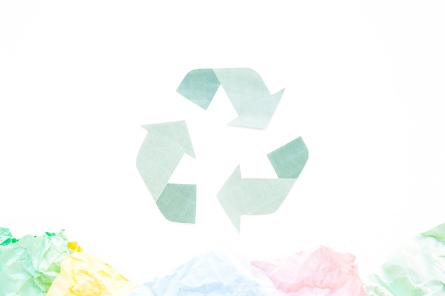Recycle logo with papers