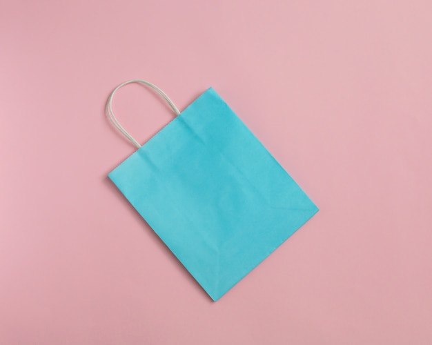 Recycle paper bag isolated on pink  mockup for design