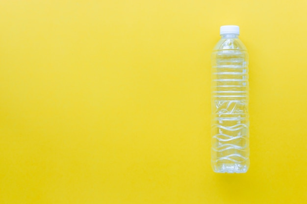Recycle plastic bottles on yellow color background