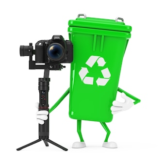 Recycle sign green garbage trash bin character mascot with dslr or video camera gimbal stabilization tripod system on a isolated background. 3d rendering