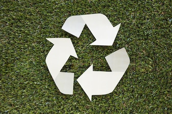 Recycle symbol on grass